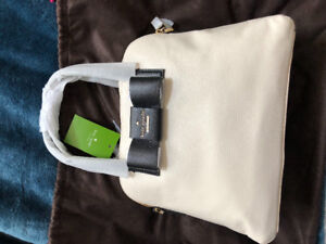 New with tags and wrapping Kate Spade Maise.