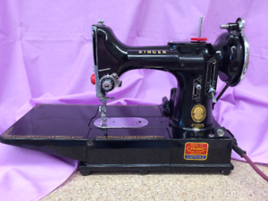 Singer Featherweight 222K free arm sewing machine, case etc.