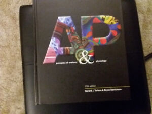 Principles of Anatomy and Physiology Hardcover – Jan 4 2011