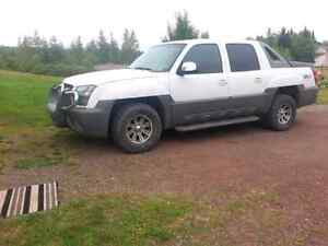 2002 avalanche fully loaded came from Alberta