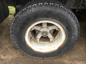 (4) FOUR TRUCK TIRES  9.00-20  or 10.00-20 WITH RIMS   NEEDED