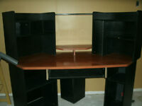 large wooden computer desk and leather computer chair