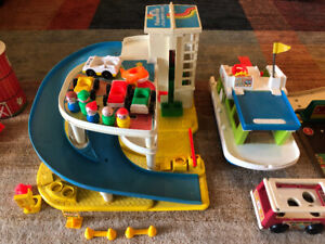 lot of vintage fisher price 2 garages, boat, barn and silo
