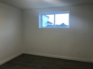 Brand New legal semi-basement suite
