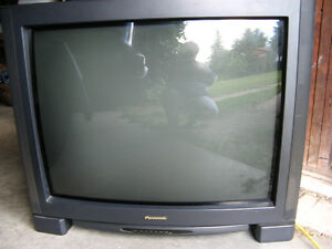 """32""""TV, VCR, and Disney VHS Movies bundle."""