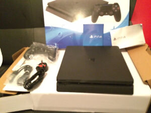 1TB PS4 Slim (Like New)  + 2 Controllers + 1 Game + PSN