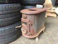 Old cast iron/ heavy metal log/coal burner/ garden/pit