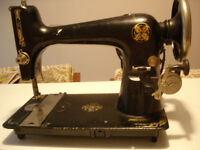 Antique sewing machine with attachments.