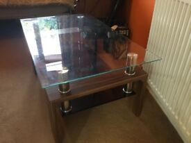 Glass top coffee table with black glass under shelf