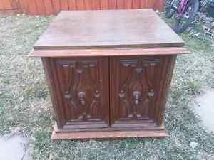 Crafted rectangular commode table with 2 curved doors