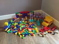 Bundle of mega blocks, including mega blocks bus, princess Lego, racing car & more