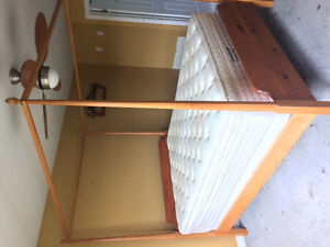 Solid honey pine pencil post canopy bed