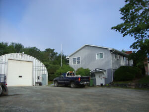 Home with 35 X 44 Steel Quonset Hut Garage