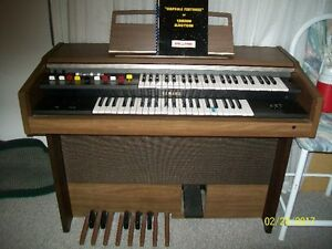 Yamaha Electric Organ with manual and song books.