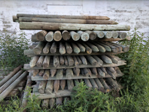 Used fence posts and railway ties