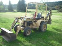 Mini backhoe for hire. Valley Greenscapes