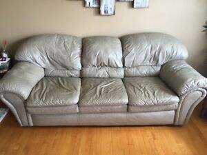 Beige leather couch. NEEDS TO GO!!!!