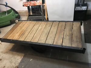 Cast Iron coffee table with wood panels