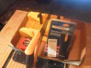 Mitre box with saw, tape and stud finder