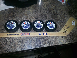 **REDUCED** Lot of signed hockey pucks  And signed mini stick