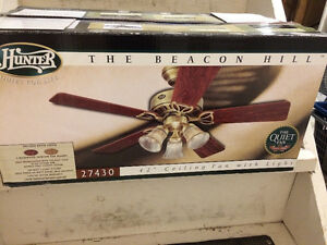 "BRAND NEW 42"" Ceiling fan with light"