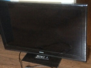 TV with stand and surround sound system with Panasonic speakers
