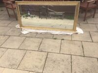 Large solid gold effect mirror
