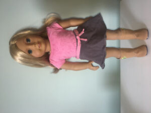 American girl doll, blonde hair, blue eyes