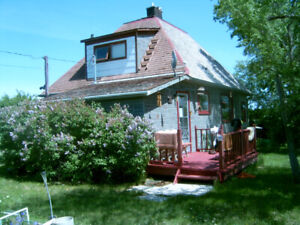 8 residential lots for sale with a 2 floor house in Aneroid SK.
