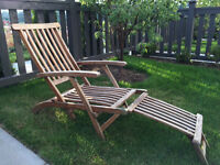 Two solid wood loungers and table