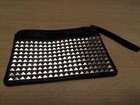 Black handbag with wrist strap