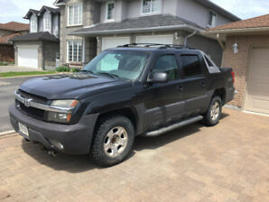 2003 Chevrolet Avalanche with Boss Plow