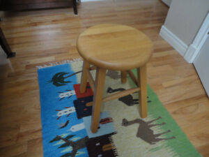 2 stools, solid wood, one natural , one painted blue.