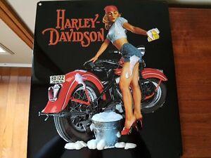 Harley Davidson metal signs of pin up girls.