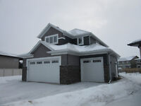 MUST SEE. Brand New. CUSTOM BUILT. Suite with garage.