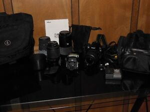Nikon camera, flash, charger, 2 bags and 4 lenses