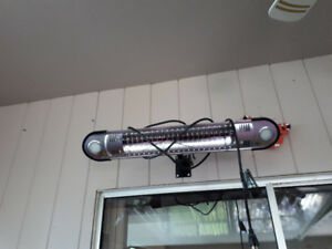 Like new indoor/outdoor wall mount Electric heater / light.