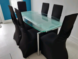 Glass Dining Table and 6 Black Faux Leather Chairs