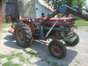 Massey Ferguson 165 with bush hog, loader and plow