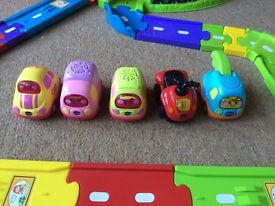 VTechToot-Toot Drivers Garage plus VTech Toot-Toot Driver Deluxe Track Set and 5 vehicles.