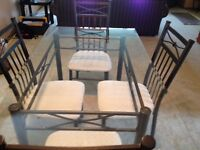 Bronze and Glass Dining Set for sale in Harbourview South!