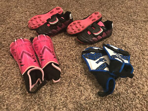 Kids soccer cleats and shin protectors