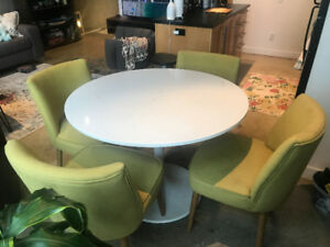 Ikea DOCKSTA table with green mid-century chairs