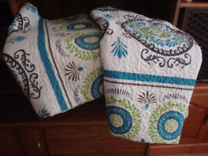 Two small quilted blankets