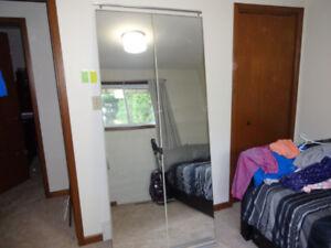 Mirrored closet bi-fold door