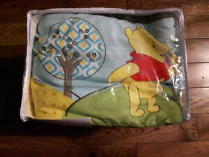 Winnie the Pooh blanket and bumper pads