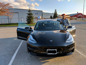 Black Tesla model 3 plus