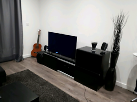 Tv table with 2x tinted glass tops