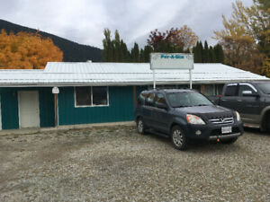 Highway Service Commercial building in Creston for rent.