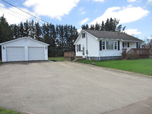 Cozy bungalow with detached garage and private backyard